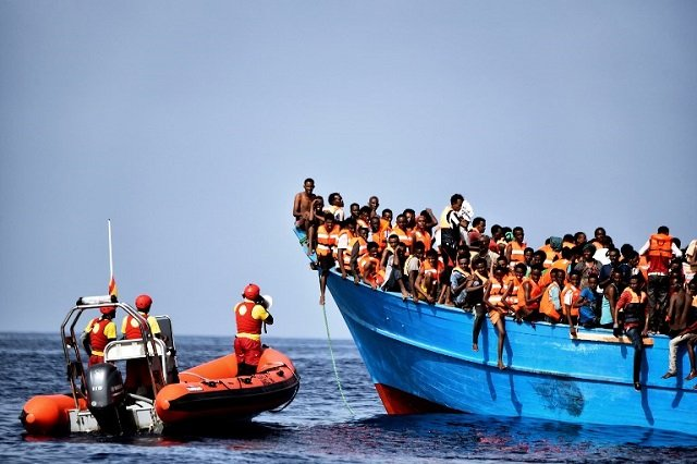Italy agrees to draw up migrant rescue 'code of conduct' with France and Germany