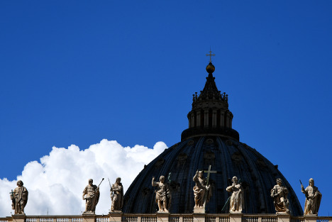 Vatican says it axed chief auditor for spying