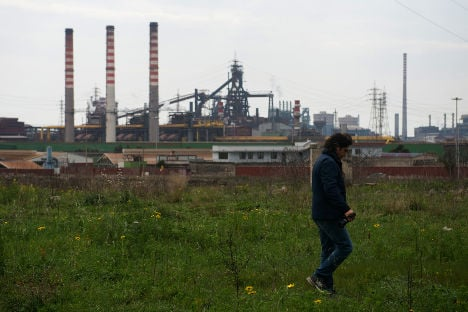 Workers at troubled Italian steel plant strike over huge job cuts
