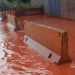 Activists demand action as water runs red near Italian steelworks