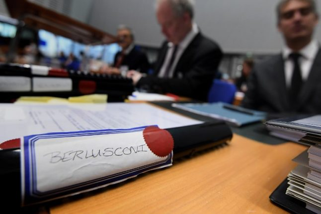 Human rights court hears Berlusconi's case against ban on public office