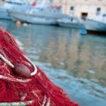 Italian fisherman 'throws migrant worker overboard' to evade police