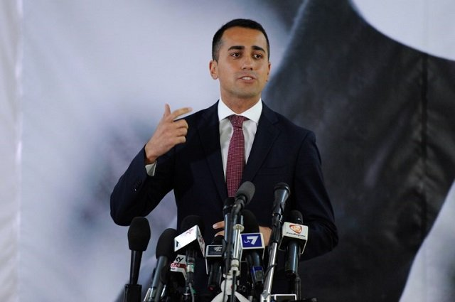 Italy's Five Star Movement leader softens stance on euro and party alliances ahead of 2018 election