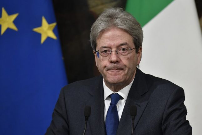 Italy's prime minister rules out 'grand coalition' with Silvio Berlusconi