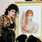 With a picture of a self portrait she donated to auction in 1999Photo: Amr Nabil/AFP