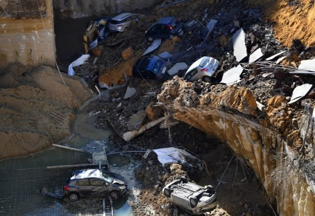 PICTURES: Massive sinkhole opens in Rome, swallowing cars