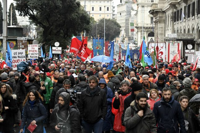 Tens of thousands march in rival protests across Italy