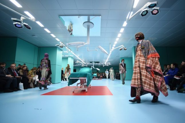 Milan Fashion Week opens with Gucci models carrying their own heads