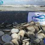 Hundreds of thousands of plastic discs are washing up on Italian beaches