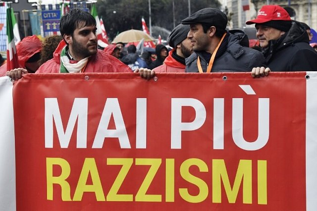 Thousands of Italians march against racism after Senegalese man killed in Florence