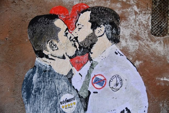 Rome mural shows Italy's political rivals kissing
