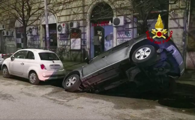Giant pothole sinks two cars in Rome