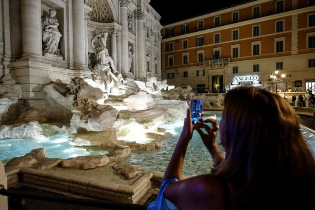 Rome tourist fined after trying to climb Trevi Fountain