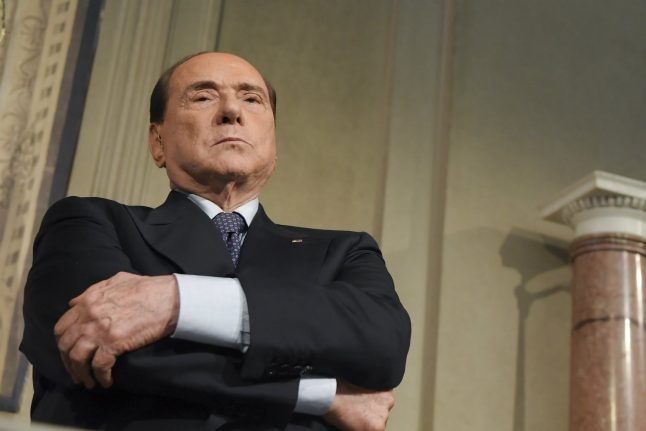 Italy court lifts ban on Berlusconi running for public office