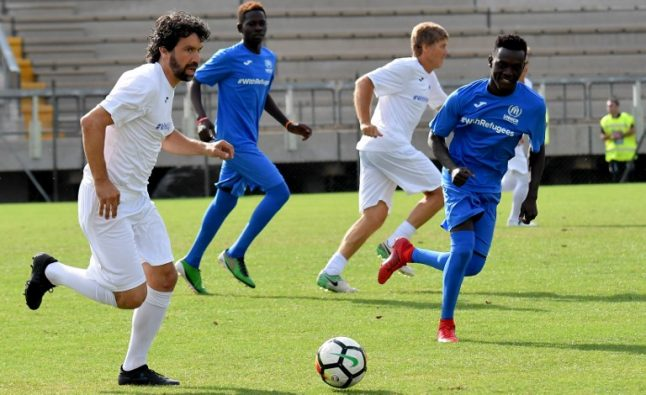 Italian football legends take on refugee team in match for solidarity