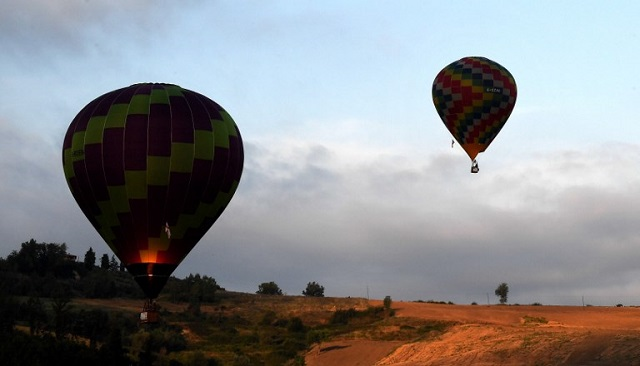 IN PICTURES: Dozens of hot air balloons fill the sky in central Italy