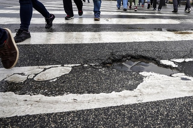 Rome residents paint potholes to alert cyclists and shame authorities after woman's death