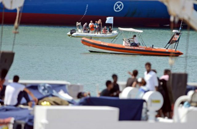 Italy lets migrants off stranded boat as deal reached