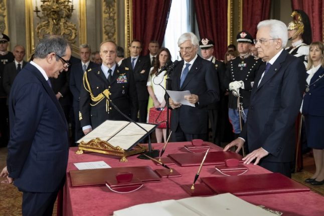 Italy's government prepares to unveil its first budget