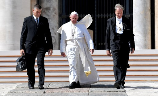 Pope calls on divided Chinese Catholics to reconcile