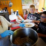 Immigrant children return to school canteens in Italian town that denied them lunch subsidies