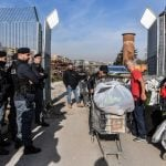 Italian police evict immigrants from Rome camp