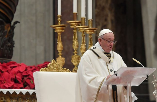 Pope urges more 'sharing and giving' in Christmas mass