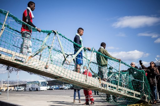 Migrants land in Sicily as ship's crew faces uncertain fate