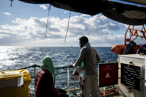 Italian ship rescues migrants as Rome vows crackdown