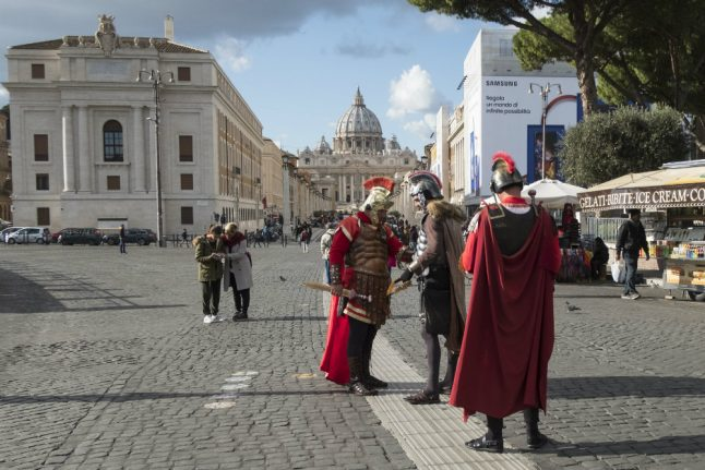 'Don't dress up as a Roman': Rome to punish tourists for messy eating and bad manners at historic sites