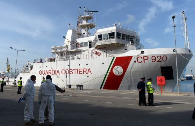 Italy agrees to let 116 rescued migrants off coastguard ship