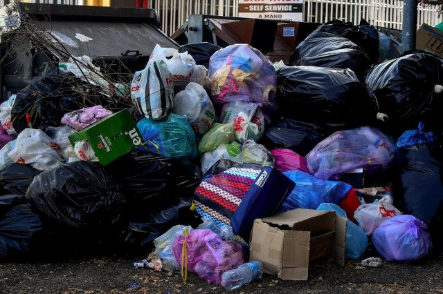 Rome residents tape bins shut in protest over rubbish crisis