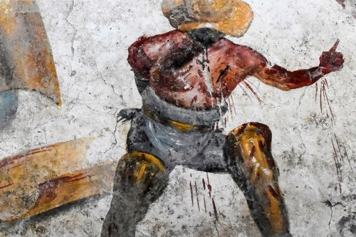 Grisly gladiator fresco discovered in tavern at Pompeii