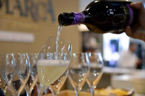 'Sadness and fear won't solve problems': Italians respond to coronavirus with wine and jokes