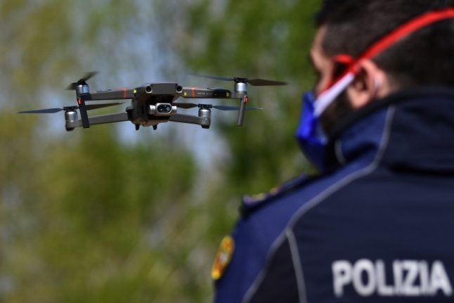Hovering police drones take Italians' temperature and issue fines