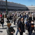 Italy considers reopening shops earlier following protests