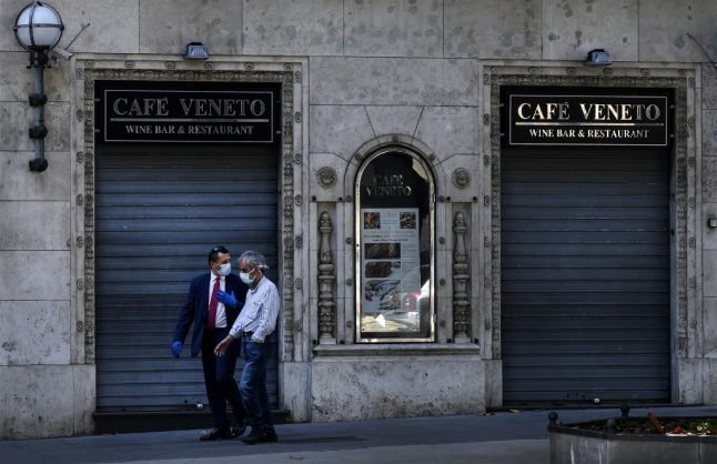 Italy's shops and restaurants struggle to reopen with new rules and few customers