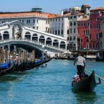 Venice reduces gondola capacity as tourists are 'getting heavier'