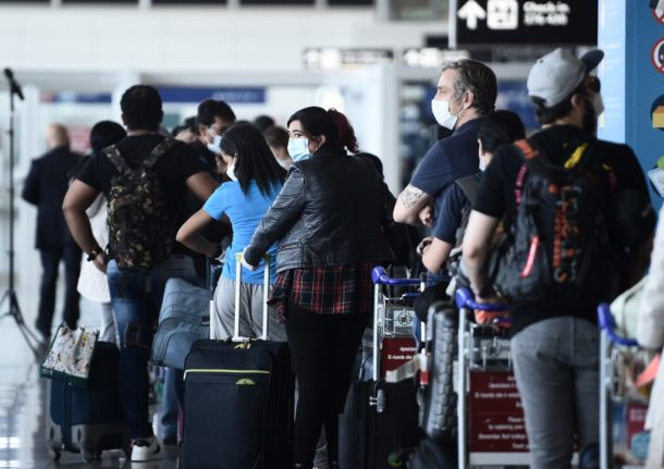 Which travellers face mandatory Covid-19 testing on arrival in Italy?
