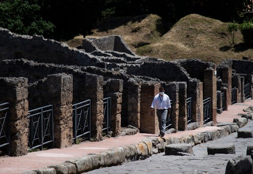 Italian researchers unearth remains of master and slave at Pompeii