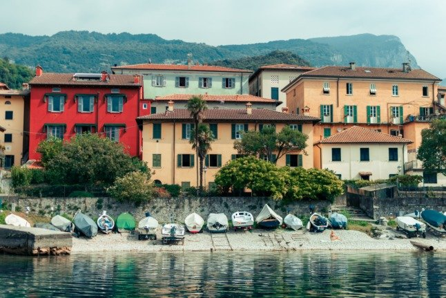 A row of houses by a lake in Lierna, Lecco
