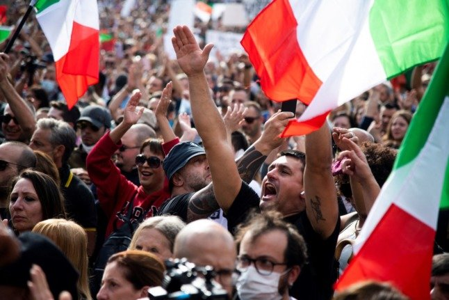 Anti-green pass protesters demonstrate in Rome before the event descends into violence on October 9, 2021.