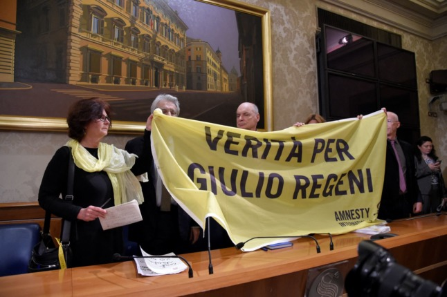 The parents of Giulio Regeni hold a banner reading ''Truth for Giulio Regeni'' during a press conference with Senator Luigi Manconi, president of the Human Rights commission at the Italian Senate, on March 29, 2016 in Rome.