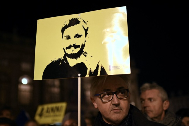 Activists take part in a demonstration in Piazza Castello in Turin on January 25, 2020, to mark the fourth anniversary since the disappearance of Italian student Giulio Regeni.